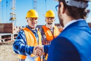 construction-worker-in-protective-uniform-shaking hands